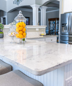 Arctic Ivory Quartz kitchen island on white cabinet base