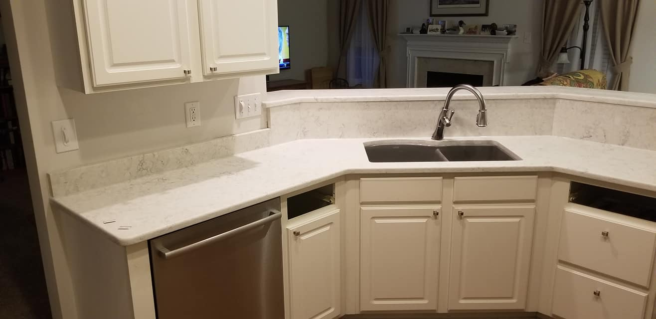 Aspen Quartz kitchen countertop install with white cabinets