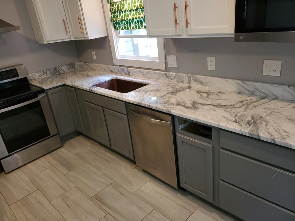 mont-blanc-marble-kitchen-countertops-with-gray-cabinetry